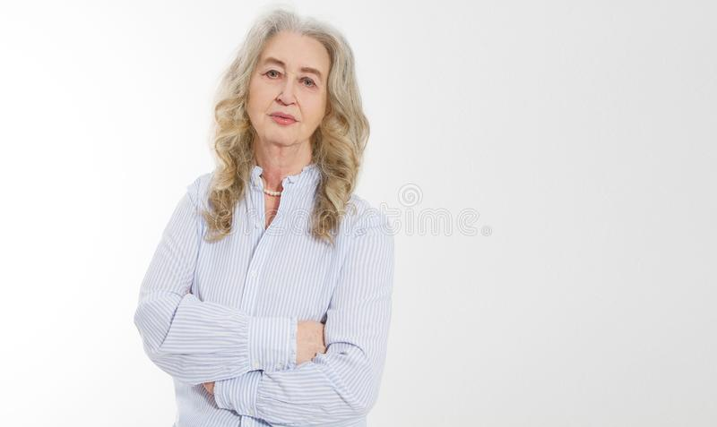 Happy senior woman with crossed arms isolated on white background. Positive elderly seniors life living and european old beauty stock image