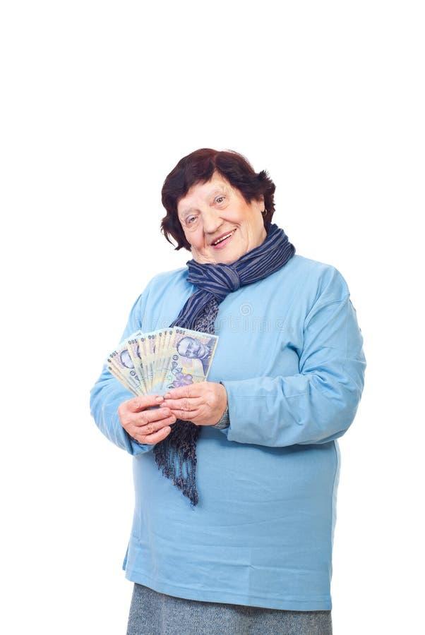 Happy senior woman holding Romanian cash stock photo