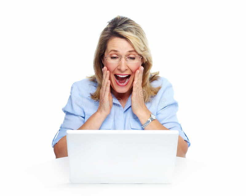 Happy senior woman with laptop computer. Isolated over white background royalty free stock images