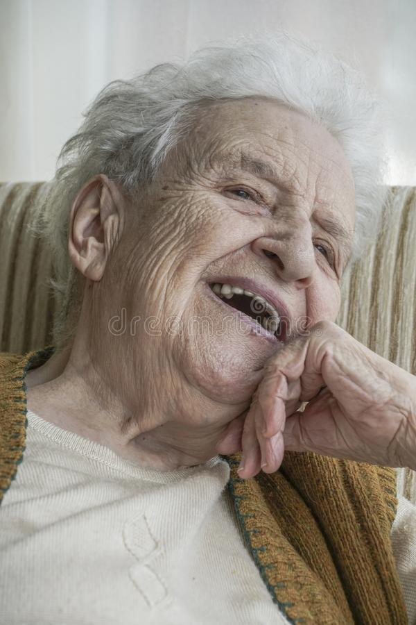 Happy senior woman laughing royalty free stock photography