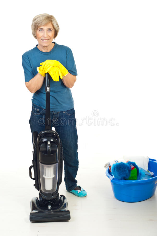 Happy senior woman ready for housework royalty free stock image
