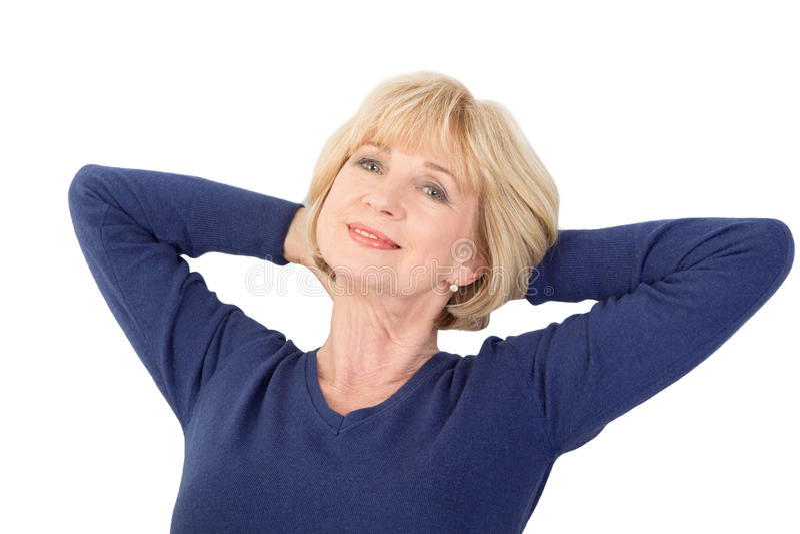 Happy senior woman sitting isolated on white background stock photo