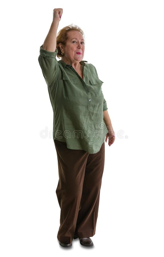 Happy senior woman standing with arm raised stock images