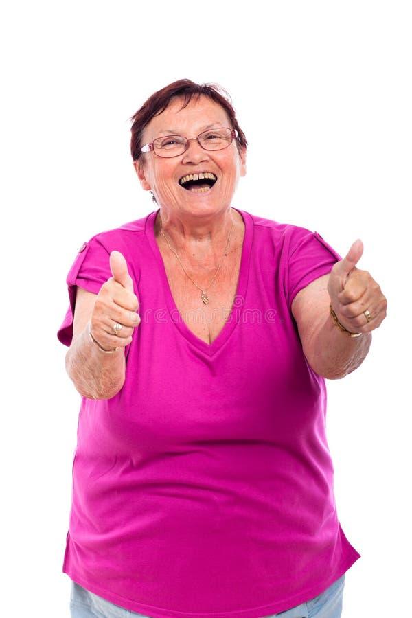 Happy senior woman thumbs up royalty free stock photos
