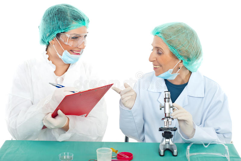 Happy senior and young women scientists royalty free stock photos