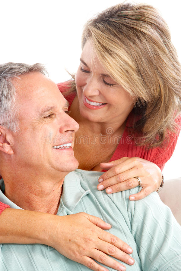 Happy seniors. Couple in love. Isolated over white background royalty free stock images