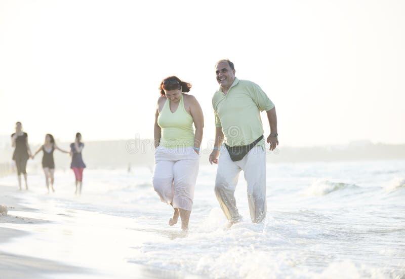 Download Happy Seniors Couple  On Beach Stock Photo - Image of seaside, outdoors: 15348460