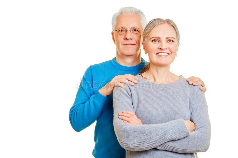 Happy seniors couple isolated in front of white stock photo