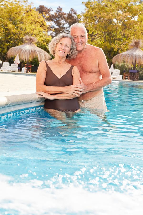 Senior couple in the pool of the Wellness Hotel royalty free stock photos