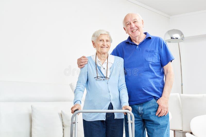 Happy seniors couple in their apartment. Happy seniors couple side by side in their apartment or retirement home stock image