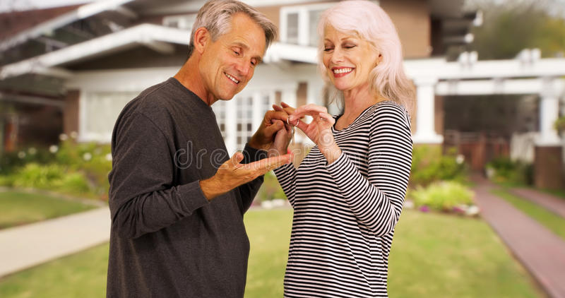 Happy seniors excited for their new purchased home stock photography
