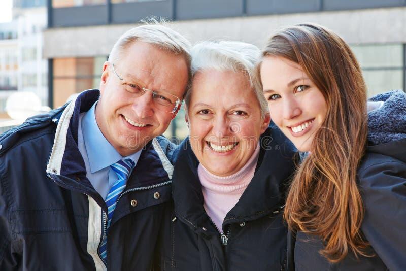 Happy seniors with grandchild stock photography