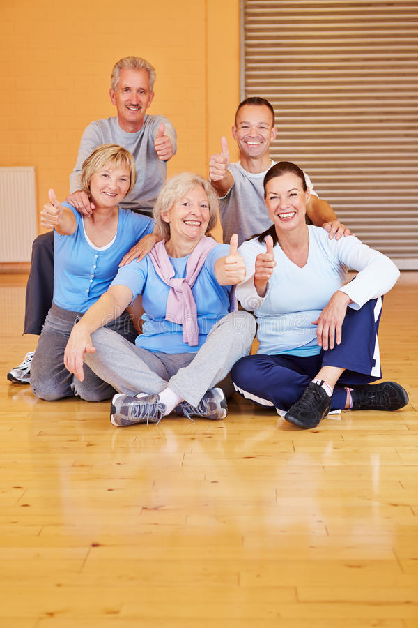 Happy seniors holding thumbs up stock images