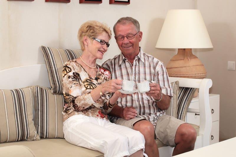 Happy seniors at home stock photo