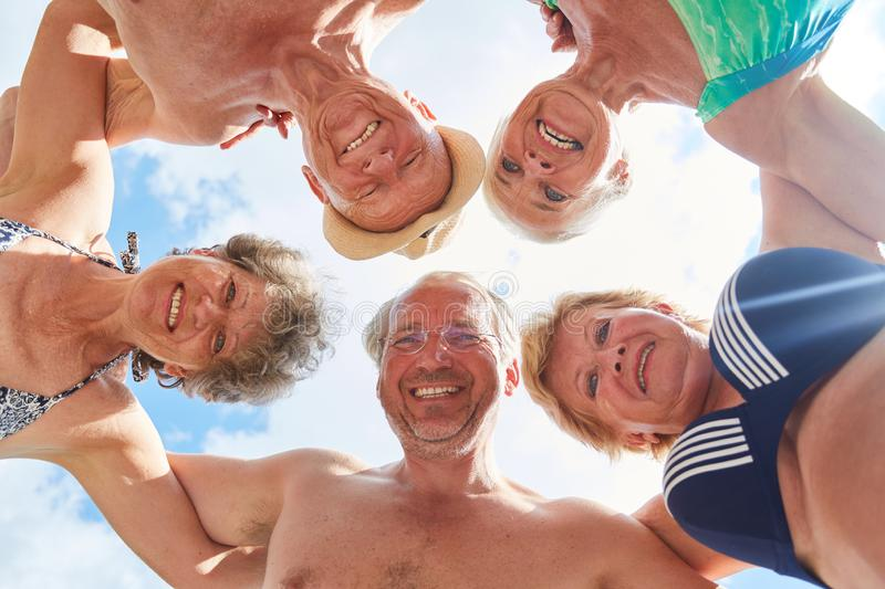 Happy seniors in summer vacation in the circle stock photos