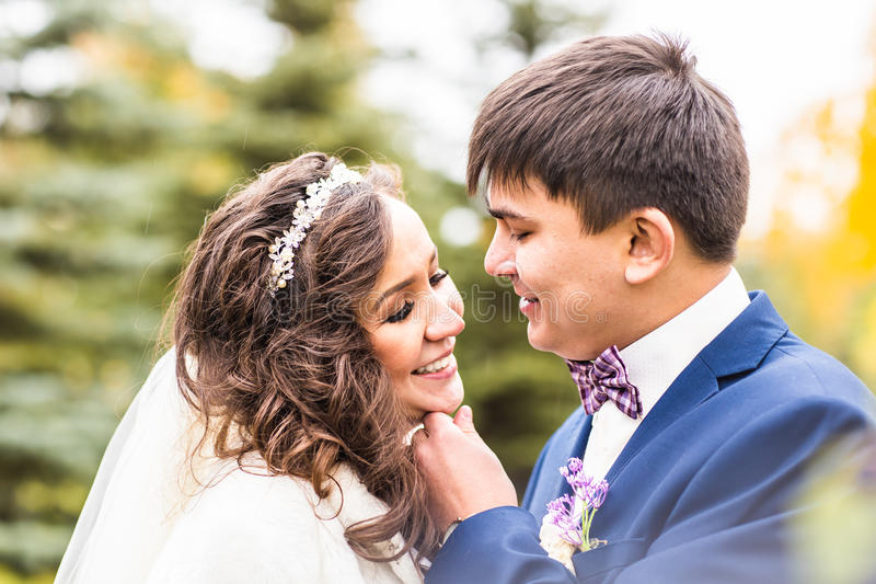 Happy sensual handsome groom and bride hugging close-up royalty free stock photo