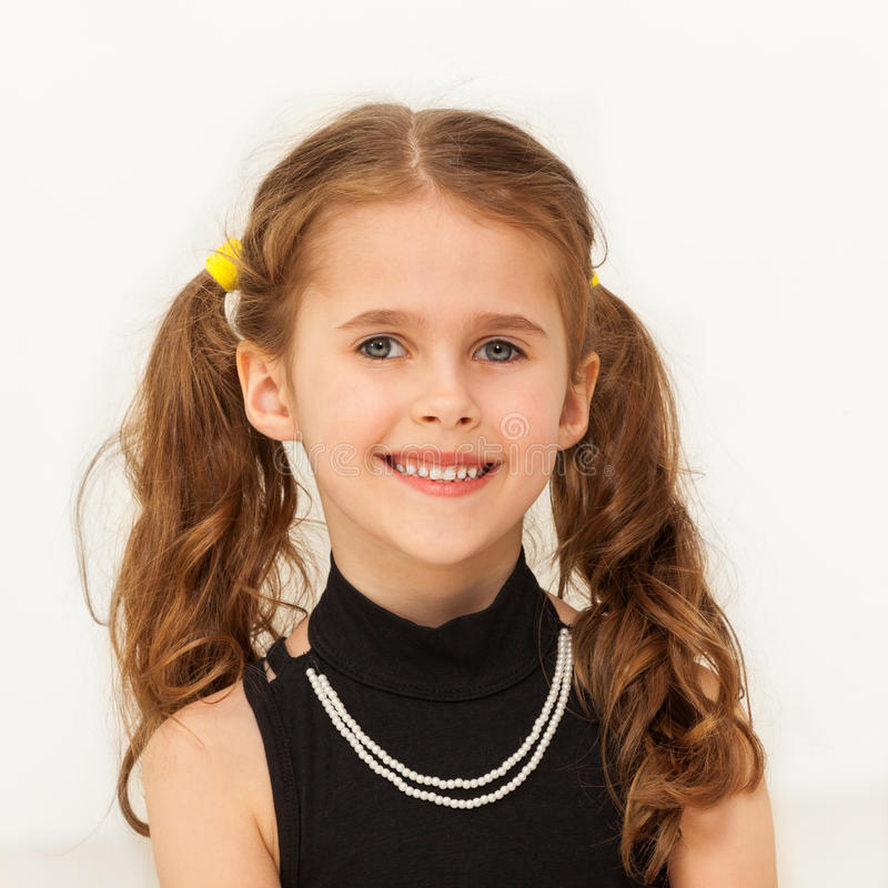 Happy seven years old girl smiling at camera stock image
