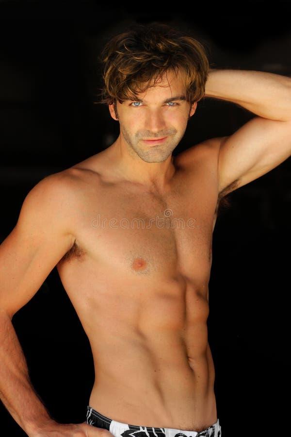 Happy shirtless man stock photography