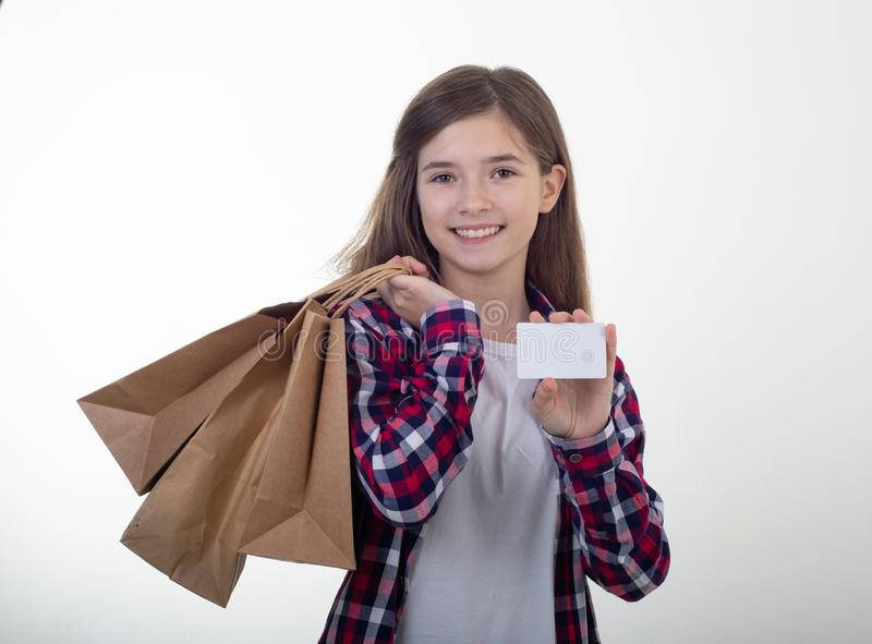 Happy shopper holding discount white card and shopping bags and carton boxes in her hands. stock images
