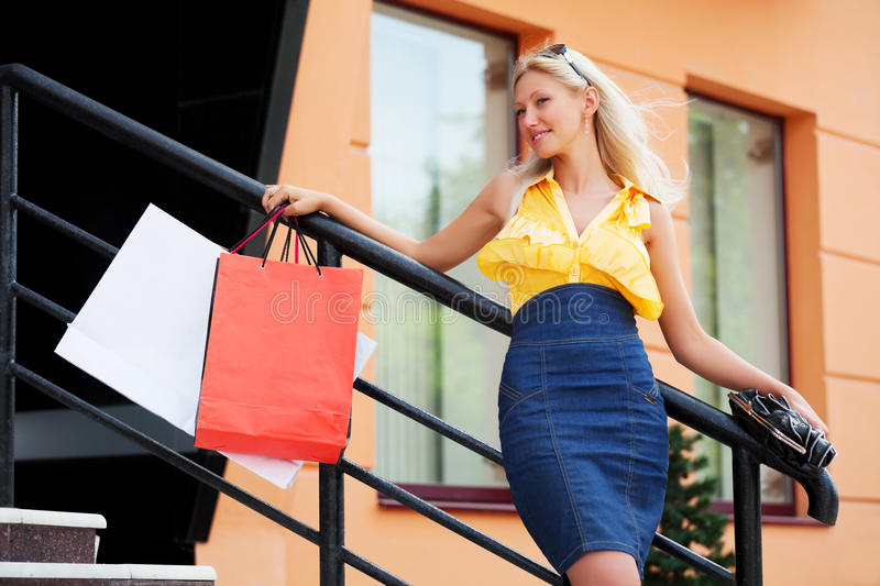 Download Happy Fashion Woman With Shopping Bags At The Mall Stock Photo - Image: 19049620