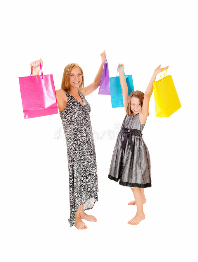 Happy shoppers. Happy mother and daughter holding up there shopping bag's, isolated for white background royalty free stock photography