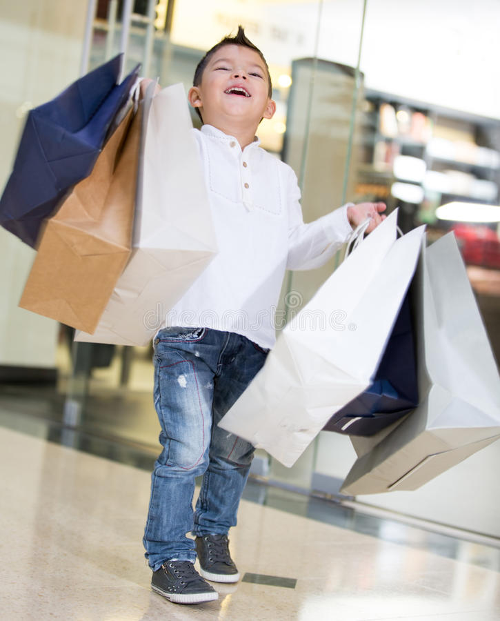 Download Happy shopping boy stock image. Image of child, center - 30042577