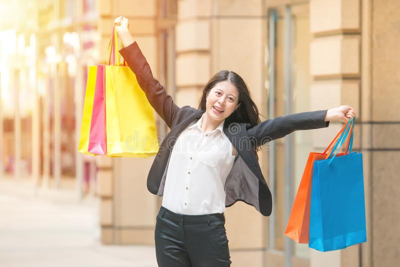 Happy shopping business woman in excited winning stock photo