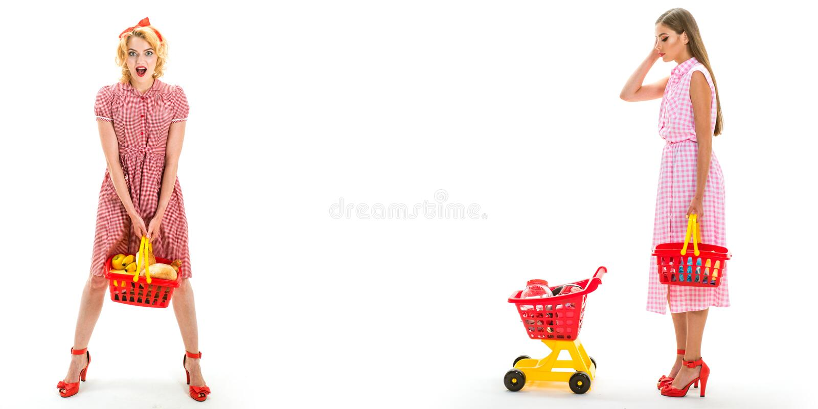 Happy shopping girls with full cart. vintage housewife women going to make payment in supermarket. savings on purchases stock image