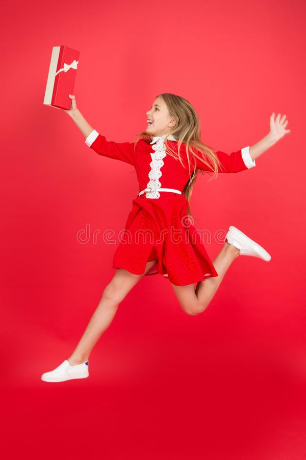 Happy shopping online. big sale in shopping mall. Birthday and christmas presents. International childrens day. small. Girl child with shopping bags. Clothing stock image