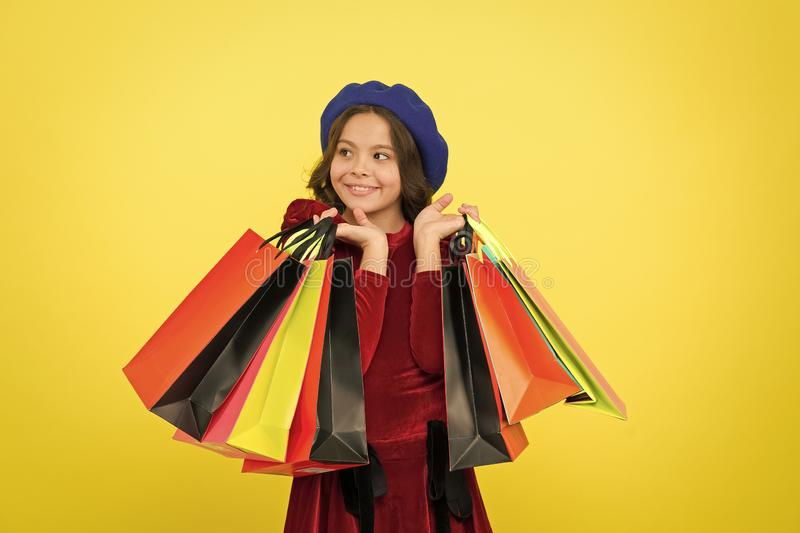 Happy shopping online. Birthday and christmas presents. International childrens day. big sale in shopping mall. small. Girl child with shopping bags. Own stock photo