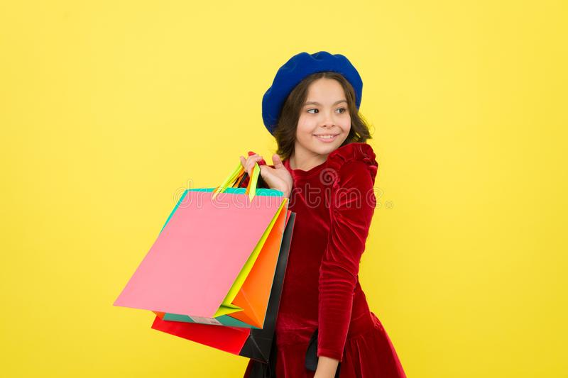 Happy shopping online. small girl child with shopping bags. big sale in shopping mall. Birthday and christmas presents. International childrens day. Taking two stock photography