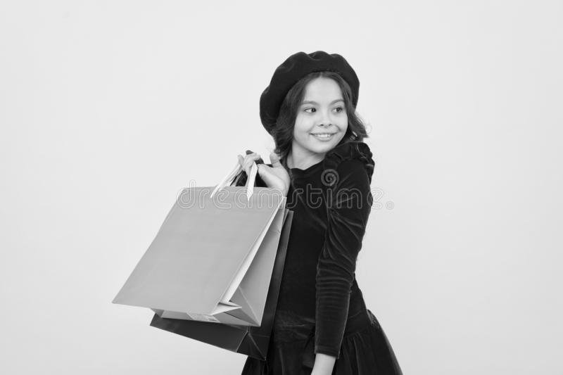 Happy shopping online. small girl child with shopping bags. big sale in shopping mall. Birthday and christmas presents. International childrens day. Taking two royalty free stock image