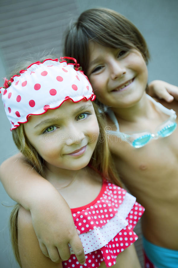 Happy siblings enjoying summer royalty free stock photography