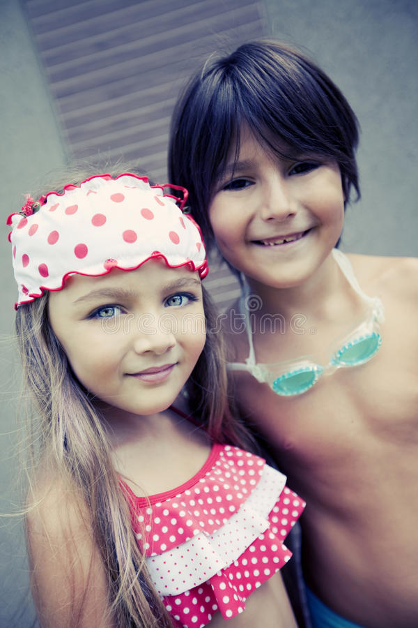 Happy siblings enjoying summer stock photography