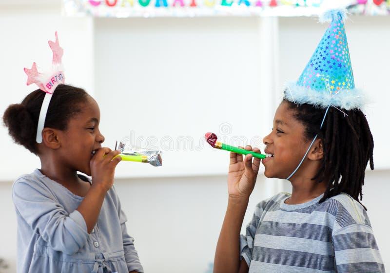 Happy siblings having fun at a birthday party royalty free stock photos