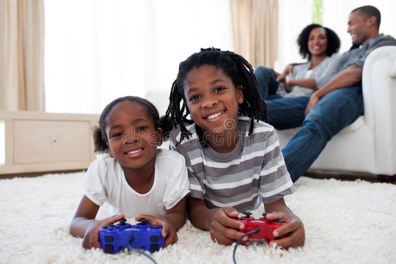 Happy siblings playing video game royalty free stock image