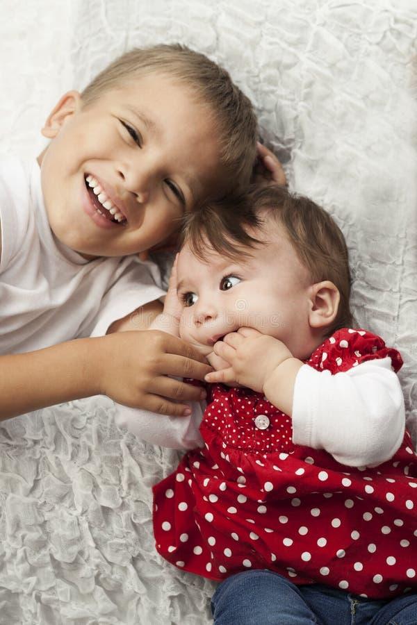 Happy siblings royalty free stock image