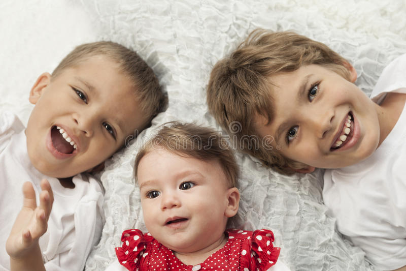 Happy siblings stock photos