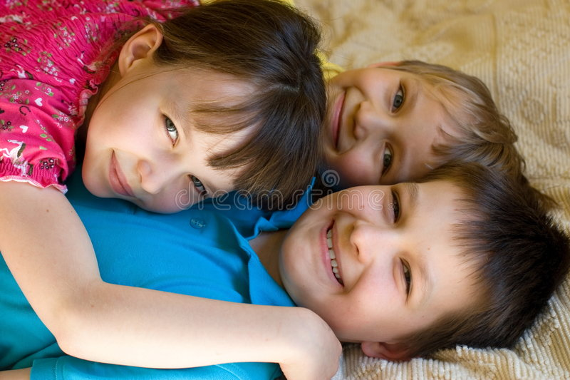 Happy sister with brothers royalty free stock images
