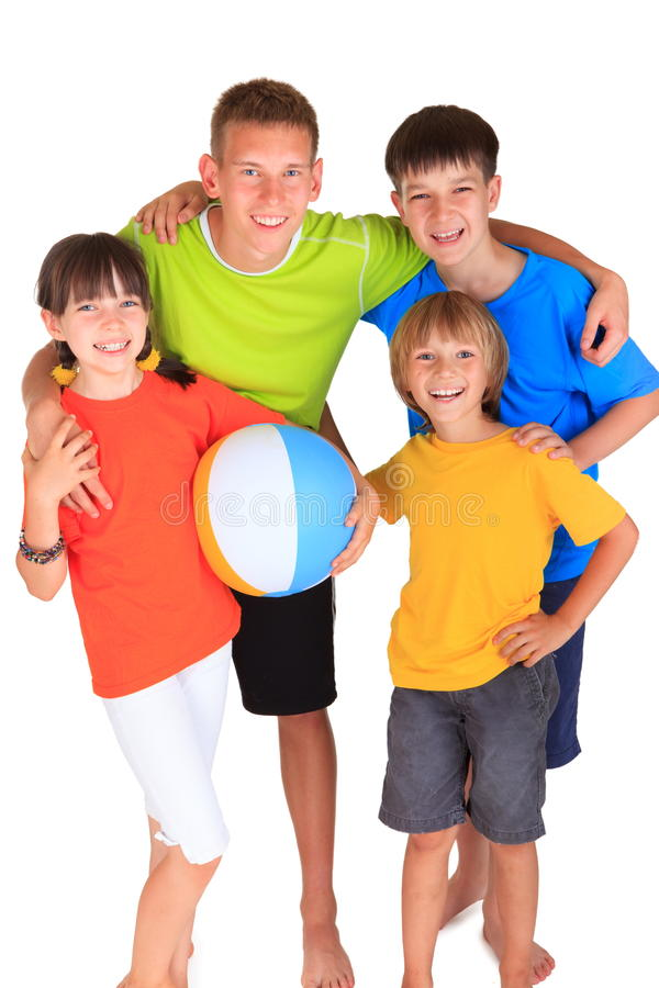 Happy sister with brothers. Colorful portrait of three brothers standing next to their sister who is holding a beach ball royalty free stock photography