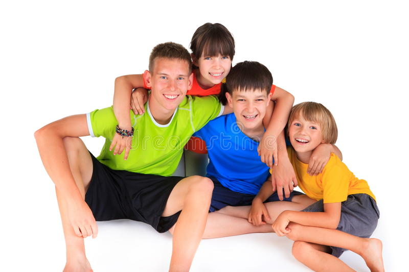 Happy sister with brothers. Colorful portrait of happy smiling children including a sister with her three brothers seated and on white background royalty free stock images