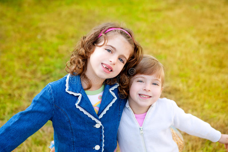 Download Happy Sister Girls In Winter Park Grass Playing Royalty Free Stock Images - Image: 21393029