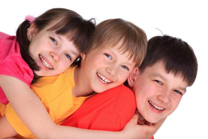 Happy sisters and brothers. Happy young sister with two brothers isolated on white background stock photography