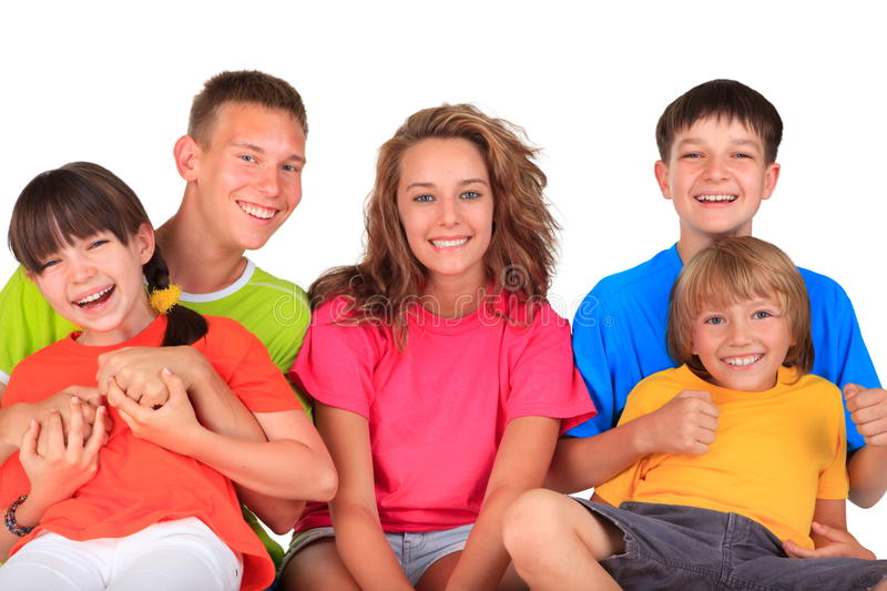 Happy sisters and brothers. Five happy young brothers and sisters in colorful clothes smiling, white background stock photos