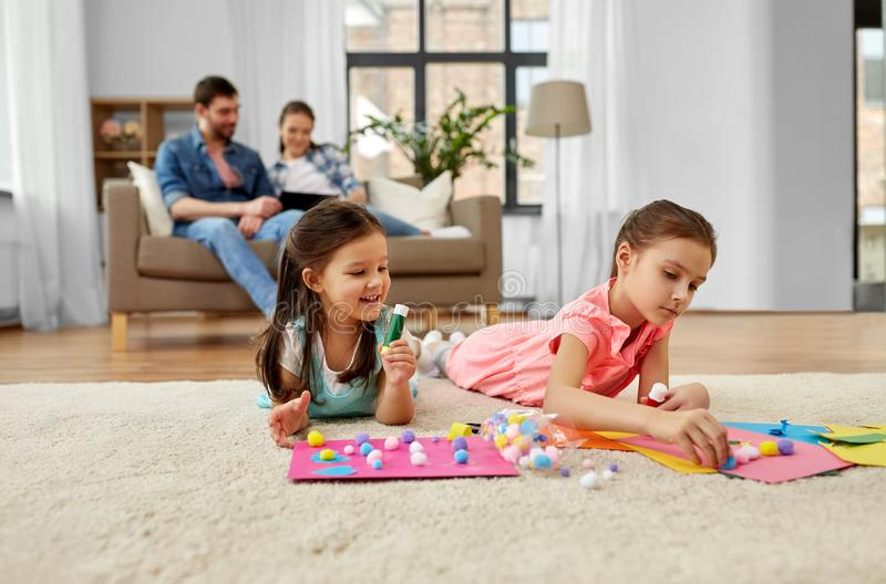 Happy sisters doing arts and crafts at home royalty free stock image