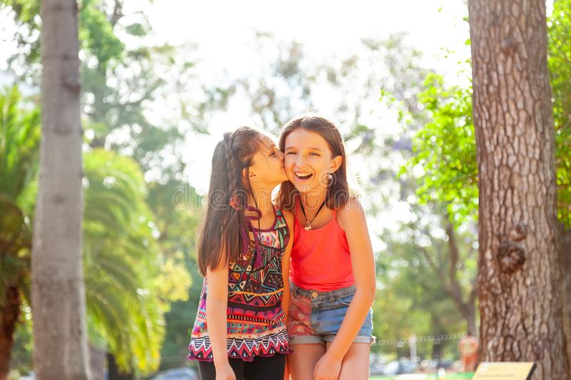 Happy sisters having fun outdoors royalty free stock photography