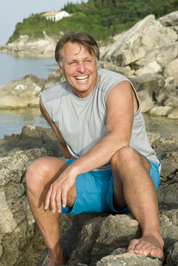Download Happy sitting on a rock stock image. Image of smiling - 15268803