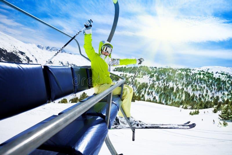 Happy skier on ski lift royalty free stock photo