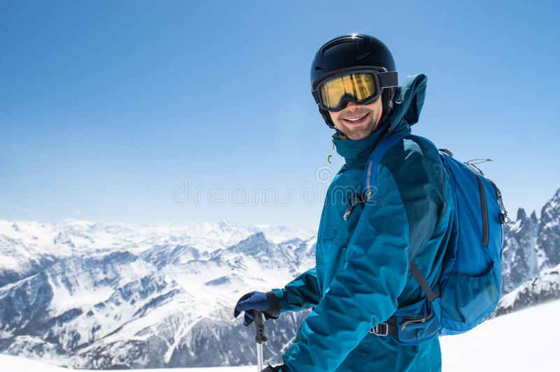 Happy skier at snow mountain royalty free stock image