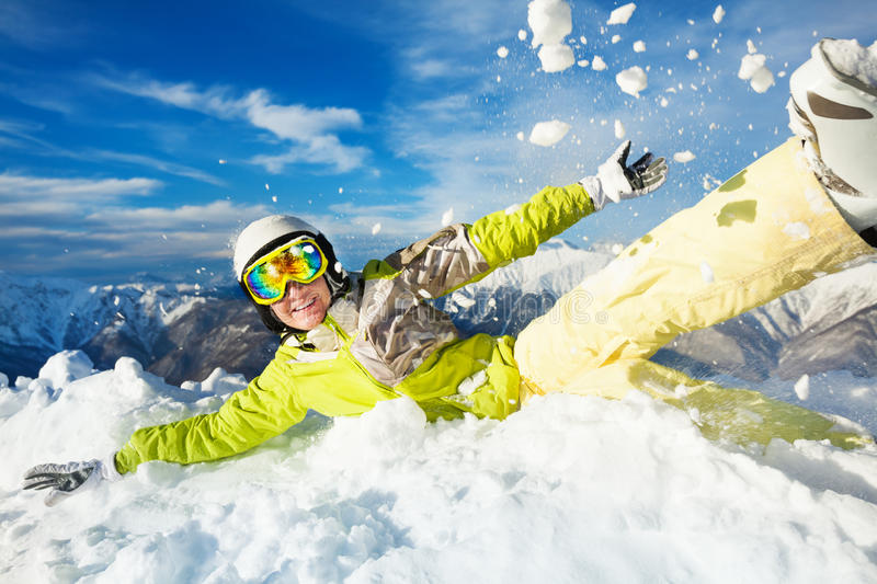 Happy skier woman jump in and throw snow stock photography